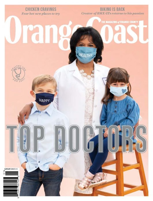 Orange Coast Top Doctors Magazine cover, dentist with two young patients, all wearing masks